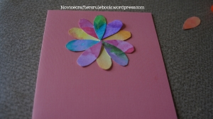 Arrange and glue the flower petals down. It's okay if they don't meet in the center.